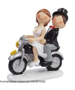 Hochzeitspaar auf Motorrad